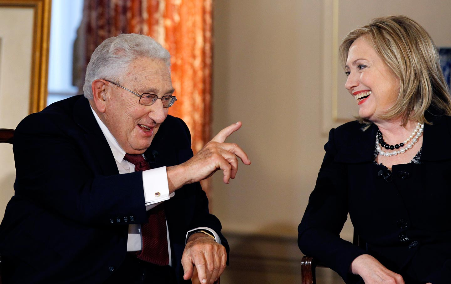 Hillary Clinton with Henry Kissinger.