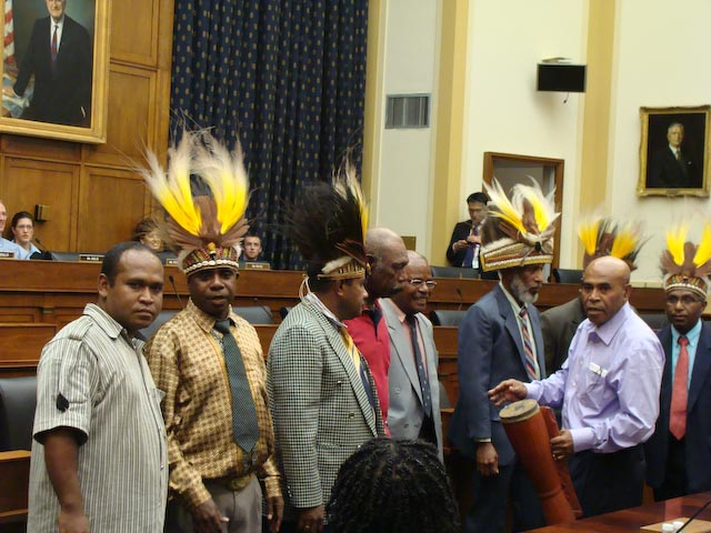 Papuans prepare to sing at opening of hearing.